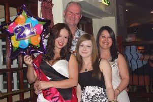 Kerry Harvey (left) with her mum Eileen (right) and her dad and sister Amy on her 21st birthday