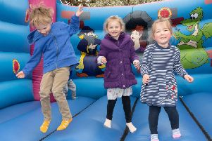 Enjoying themselves on the bouncy council at the Hi-5 Fun Day. Picture: Keith Woodland