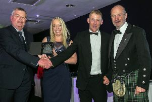 Chantelle and Peter Williams (centre) with Fishing News editor David Linkie (left) and comedian Fred MacAulay