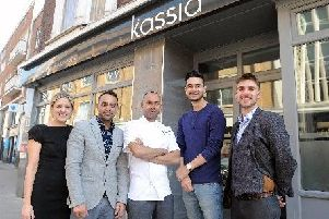 Kaz Miah, owner and head chef(middle) promising free curry at his Southsea restaurant if England win the World Cup. Picture: Johnston Press