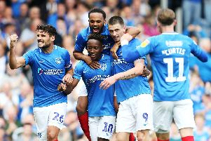 Pompey celebrate Jamal Lowe's first goal against Oxford. Picture: Joe Pepler