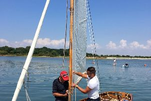 Joshua Smith and his father Paul Smith re-rigging Florence