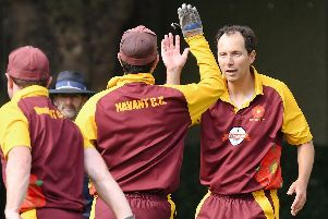 Richard Hindley, right, has become the first player to take 500 wickets in the Southern League premier division. Picture: Neil Marshall