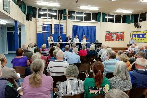 Residents meet at Peel Common Junior School to discuss Fareham Borough Council's draft local plan, which includes 475 homes in the land next to Tukes Avenue. Picture: David George