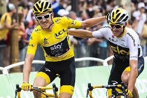Geraint Thomas celebrates with team-mate Chris Froome on the Tour de France