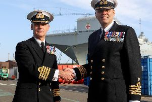 HMS Prince of Wales's new commanding officer, Captain Stephen Moorhouse, right, with the ship's former senior naval officer, Captain Ian Groom, left.'Photo: Royal Navy