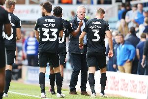 Kenny Jackett congratulates his Pompey troops after the win at Peterborough. Picture: Joe Pepler