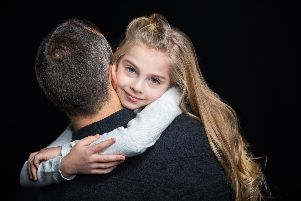What's wrong with dads hugging their sons or daughters?