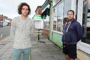 Anthony Wallace (right), 52, has vowed to keep parking outside his shop Family Tattoo on Tangier Road. His son Tony Wallace (left), 26, also uses the space