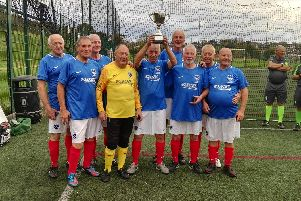 Pompey in the Community Walking Football team with their 70+ national champions trophy