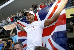 Up there with the greats - Lewis Hamilton celebrates his fifth F1 title.