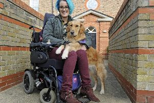 Milton resident Rachel Rawlings who suffers from ME, with her partner dog Darcy who has transformed her life. Picture Ian Hargreaves