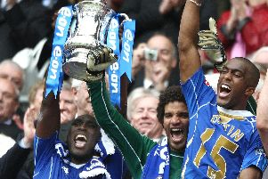 Portsmouth captain Sol Campbell with David James and Sylvain Distain lifts the FA Cup after beating Cardiff City 1-0 in the FA Cup Final at Wembley.