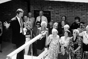 Comedian Rory Bremner addresses the crowd during the handing over ceremony at The Rowans Hospice, Purbrook in August 1994