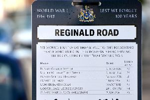 A sign placed on Reginald Road in Portsmouth, Hampshire commemorating those who lived on the street and died in the First World War. c
