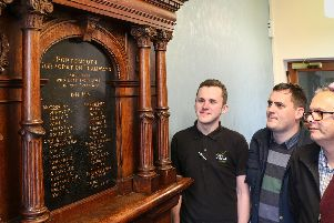 From left, Lee Willis from the Guildhall, James Daly from Portsmouth City Council's museums service, Nick Coles from the Guildhall, 'and Tim Gower from the museums service - all installed the memorial in its new position
