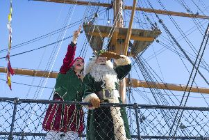 Father Christmas and Miss Chief on the bridge of HMS Warrior 1860 at Portsmouth Historic Dockyard's Festival of Christmas.  Picture: Chris Stephens.