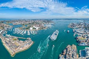 An aerial view of HMS Queen Elizabeth arriving in Portsmouth earlier this year. Picture: Shaun Roster