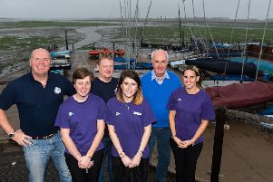 Centenary of Emsworth Sailing Club - (back row l-r) Jeremy Greaves, Oliver Clift and Commodore Michael Geary and (front row l-r) younger members Unity Bowns, Becki White and Eloise Clift with some of the club's boats behind