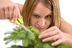 Lesley had to prune her Christmas tree to make it fit the room.