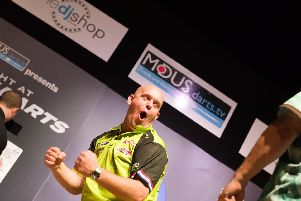 Michael Van Gerwen celebrates at Portsmouth Guildhall. Picture: Duncan Shepherd