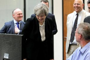 Theresa May enjoying the fishing page with Simon Carter.