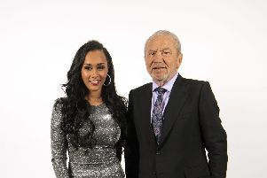 The winner of the latest series of the BBC programme The Apprentice, Sian Gabbidon, celebrates with Lord Sugar