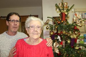 Gordon White and his mum Phyllis, pictured next to the Christmas treeand decorations that their donations havepaid for since 2016