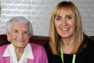 Daring Doris Long MBE, a world record holder after abseiling down the Spinnaker Tower at the age of 101 in 2015 to raise money for the Rowans, with Hospice Companion Ruth Davies