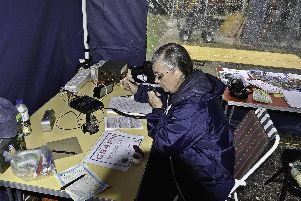 Julia Tribe uses a transceiver at one of the radio club's outreach events.