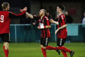 Scott Hamilton, centre, celebrates his goal in Fareham's win over Bashley. Picture: Chris Moorhouse