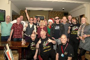 Volunteers from The Flash radio based in Leigh Park at their Christmas get-together at The Red Lion in Cosham. The team will help to bring a community service to Waterlooville.