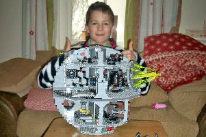 Simon Carter's son Ben, then aged nine, building the Death Star out of Lego.