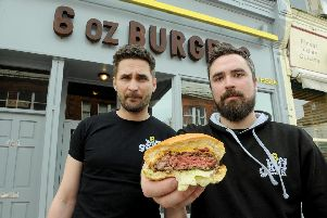 Piotr Mientkiewicz, left, and James Baldry of 6oz Burgers in Southsea in 2015 with one of the 'pink' burgers 'Picture: Paul Jacobs (150495-9)