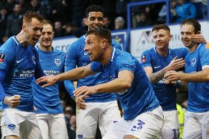 Lee Brown leads the Pompey celebrations following the opener in Saturday's 1-1 FA Cup draw with QPR. Picture: Joe Pepler/Digital South