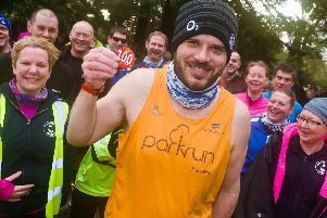 Rob Langley of Portsmouth Joggers on his 100th parkrun. Picture: Duncan Shepherd