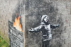 Artwork by Banksy found in Tailbach in Port Talbot, Wales. The Bishop of Portsmouth, Christopher Foster says graffiti has been around for thousands of years depicting and mocking Christians Photo credit: Ben Birchall/PA Wire