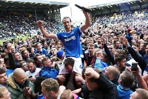Christian Burgess celebrates Pompey's promotion at Notts County with the fans Picture: Joe Pepler