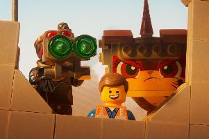 Lucy (voiced by Elizabeth Banks), Emmet (Chris Pratt) and Unikitty (Alison Brie) in The Lego Movie 2.