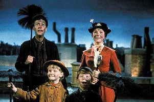 Mary Poppins, complete with soot on face, in the 1964 film