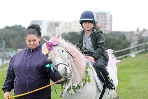 Princess the Unicorn was offering rides at Southsea Model Village for children during half term. Pictured is: Cody Davis (seven) of Fratton, with Clare Ward.'Picture: Sarah Standing (180219-1380)