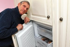 Michael Lilly with his freezer      Picture by  Malcolm Wells (190220-3928)