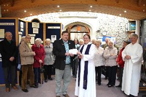 The Rev Jenny Gaffin presents the cheque to Ray Harris from SAAFA, along with members of the St Peters congregation, from donations raised through the Hayling Poppy Cascade