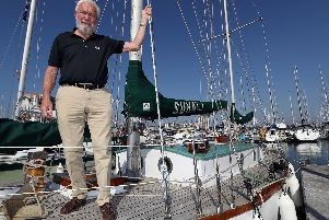 Sir Robin Knox-Johnston stands on the deck of his boat Suhaili on which he became the first person to sail non-stop around the world. Picture: Andrew Matthews/PA Wire