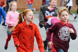 Summer-May Barham enjoys the fun run at Bedenham Primary School. Picture: Sarah Standing (150319-2728)