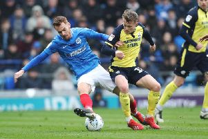 Tom Naylor in action against Scunthorpe in a game that kept Pompey on the tails of the top three / Picture: Joe Pepler