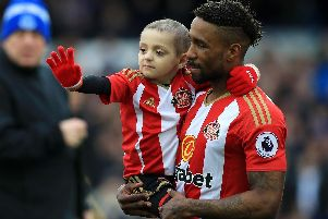 Bradley Lowery and Jermain Defoe, who formerly played for Pompey. Picture: Peter Byrne/PA Wire