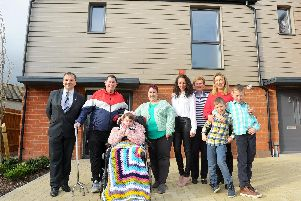 Cllr. Darren Sanders, Ian and Lisa Rapson with their daughter Danielle who will be moving into their house on April 15, family of Fred Francis, Julia Hazell, Diane Francis and Catherine Francis-Botting with her sons Luke and Callum''Picture: Sarah Standing (180319-2359)