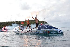 Peter Ketley and Neil Young celebrating after rowing across the Atlantic Picture: www.grandadsoftheatlantic.com