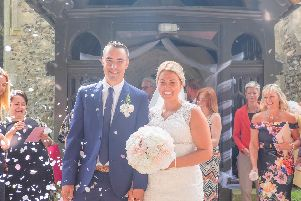 Jade and Darren Walkley outside Westbourne Church on their wedding day. Picture: Carla Mortimer Photography